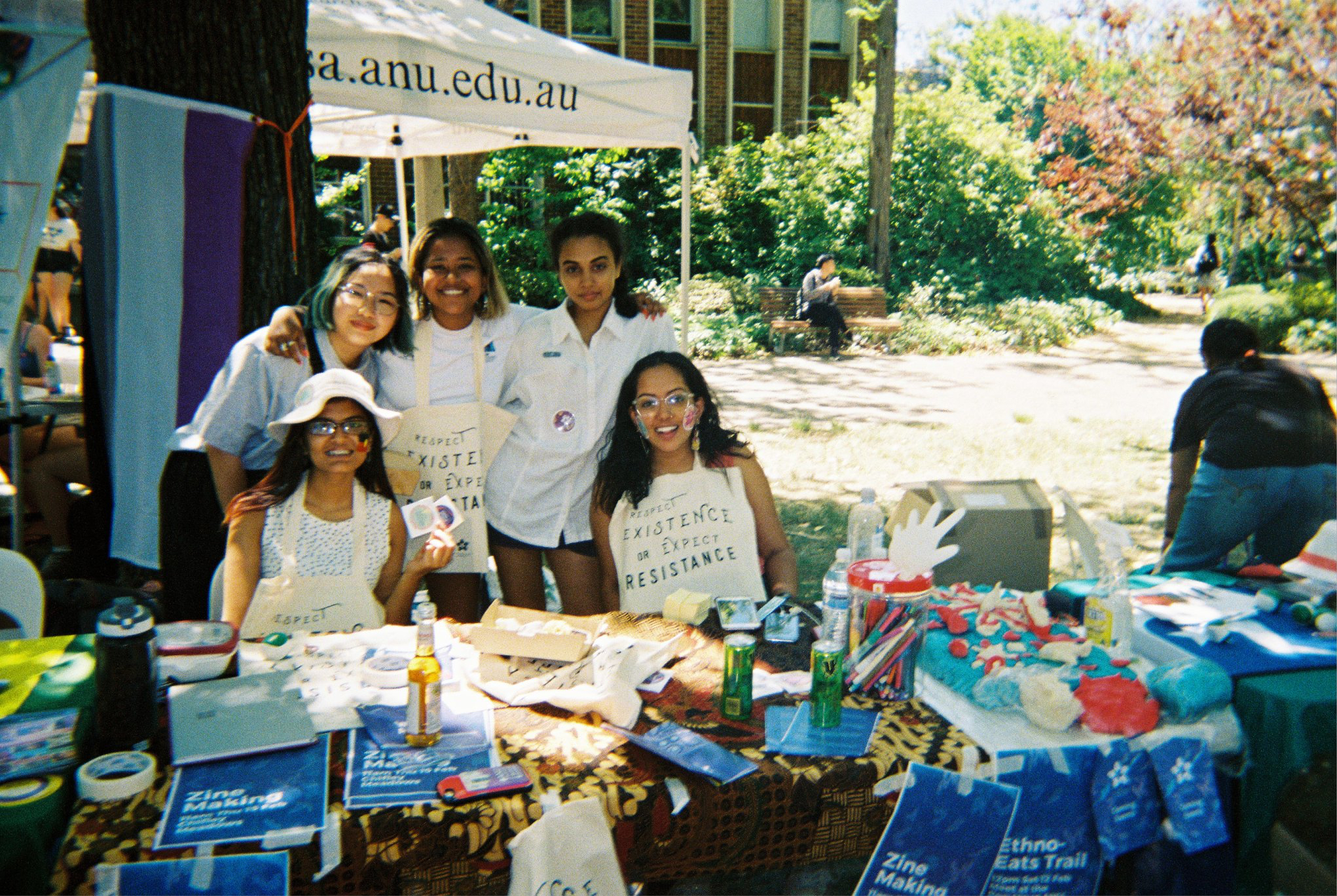 The Ethnocultural Department Executive sitting at a stall